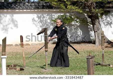 KAGAWA, JAPAN - OCTOBER 25: Katana sword fighters at Marugame Iai Festival, event dedicated to Japanese culture and tradition at Marugame-castle on October 25, 2015 in Japan. - stock photo