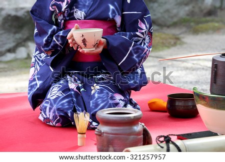 KAGAWA, JAPAN - SEPTEMBER 23, 2015: Japanese woman in traditional kimono prepares the tea ceremony at garden of the Hagiwara Temple on September 23, 2015 in Kagawa Japan. - stock photo