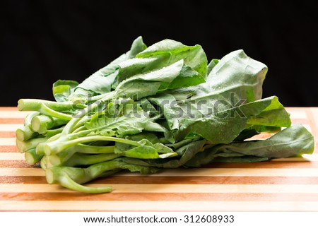 Kai-lan (also written as gai-lan) is the Cantonese name for a vegetable that is also known as Chinese broccoli or Chinese kale - stock photo