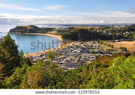 Kaiteriteri - one of the New Zealand's favourite summer holiday destinations on a beautiful morning. In the background are the towns of Mapua, Motueka and Nelson. - stock photo
