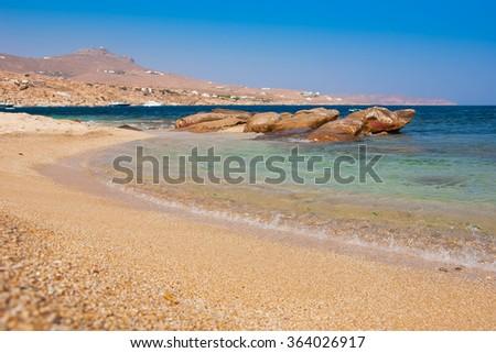 Kalafatis Bay beach on the island of Mykonos. Greece. - stock photo