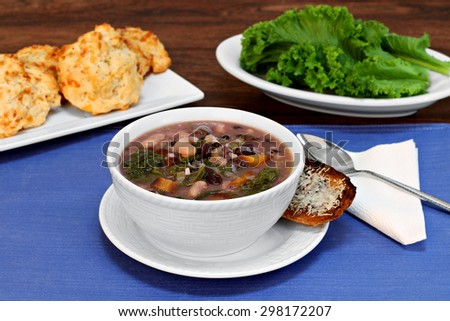 Kale and bean soup with a side of cheesy toast. - stock photo