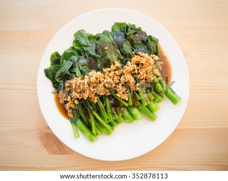 Kale fried in oyster sauce - stock photo