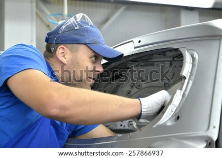 KALININGRAD, RUSSIA - SEPTEMBER 16, 2014: Worker of automobile plant - stock photo