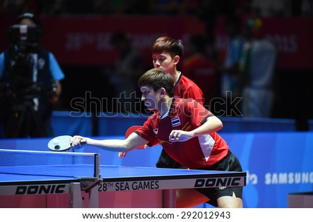 KALLANG,SINGAPORE-JUNE1:Chanakran.U and Padasak.T of Thailand in action during the 28th SEA Games Singapore 2015 between Thailand and Cambodia at Singapore Indoor Stadium on June1 2015 in SINGAPORE.  - stock photo