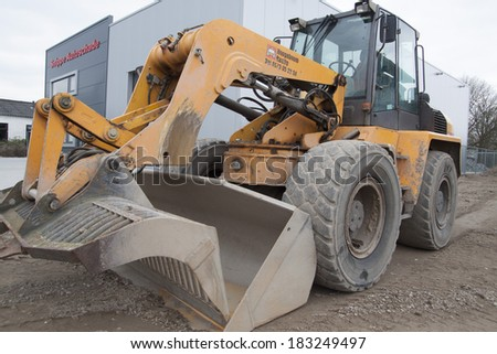 KAMPEN, HOLLAND - MARCH 1 : Parking  yellow big showel  on an industrial terain on March 1 , 2014 in Kampen,The Netherlands. - stock photo