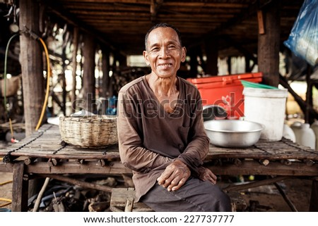 KAMPONG PHLUK,CAMBODIA - JANUARY 01: Portrait of an unidentified Khmer man on Tonle Sap Lake in Kampong Phluk,Cambodia on 01.2014 January .It is the largest lake in Southeast Asia - stock photo