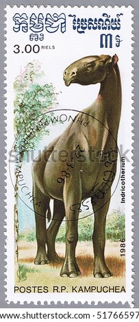 KAMPUCHEA - CIRCA 1986: A stamp printed in Kampuchea shows Indricotherium, series devoted to prehistoric animals, circa 1986 - stock photo