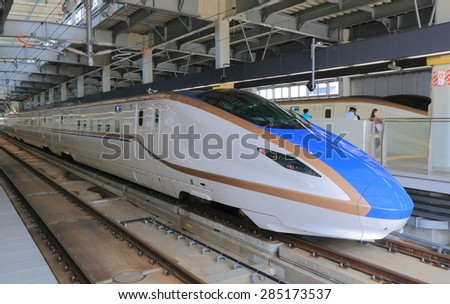 KANAZAWA JAPAN - MAY 10, 2015: Hokuriku Sinkansen bullet train. Hokuriku Sinkansen is a high speed railway line opened in March 2015.  - stock photo