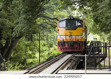 KANCHANABURI, THAILAND - AUG 30: Train on the bridge over the river Kwai (Khwae) in Kanchanaburi, Thailand on Aug 30, 2014. This bridge is famous for its history in WW2. - stock photo