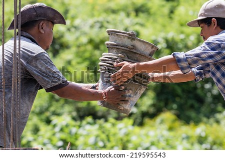 KANCHANABURI,THAILAND-SEPTEMBER 9: workers  building the house in kanchanaburi,thailand on sep 9, 2014 - stock photo