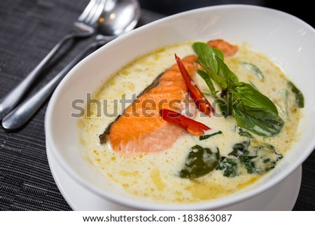 Kang kiaw wan (Green curry with grilled salmon) in white bowl - stock photo