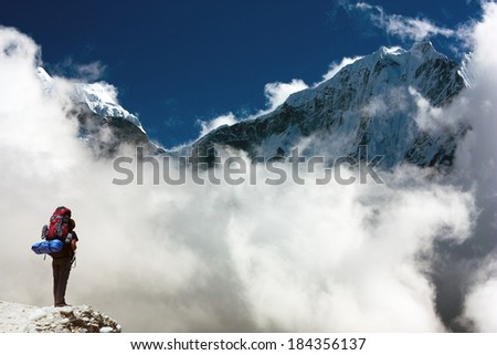 Kangtega and Thamserku with tourist - beautiful mounts above the Namche Bazar on the way to Everest Base Camp - Nepal  - stock photo