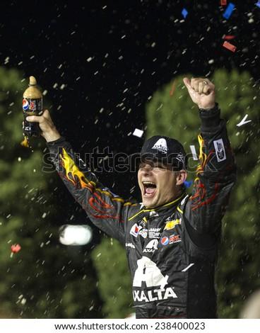"Kansas City, KS - May 10, 2014:  Jeff Gordon (24) wins the ""5-hour Energy 400 Benefiting Special Operations Warrior Foundation"" at Kansas Speedway in Kansas City, KS. - stock photo"