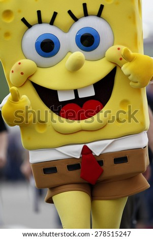 Kansas City, KS - May 09, 2015:  SpongeBob SquarePants walks down pit road before the start of the SpongeBob SquarePants 400 at Kansas Speedway in Kansas City, KS.  - stock photo