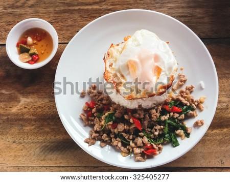 Kao Pad Kra Prao or Thai rice with pork and basil. - stock photo