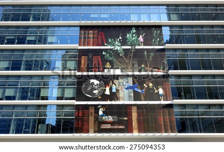 KAOHSIUNG, TAIWAN -- APRIL 18, 2015: The modern facade of the newly built Kaohsiung Main Public Library is decorated with a large art display.  - stock photo