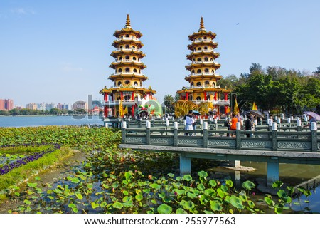 KAOHSIUNG -TAIWAN, AUGUST 9 2013: Local with Chinese-style architectural interest - Dragon Tiger Tower, August 9 2013 in Kaohsiung - Taiwan, the daily influx of so many tourists come to play. - stock photo