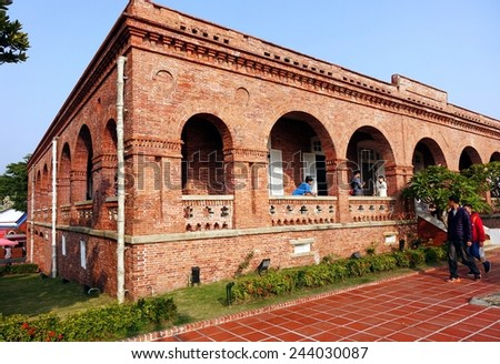 KAOHSIUNG, TAIWAN -- JANUARY 1, 2015: Tourists visit the former British Consulate, which was originally built in 1865 and has recently been restored. - stock photo