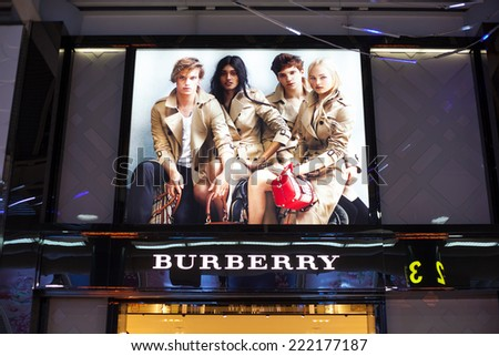 KAOHSIUNG, TAIWAN - JULY 12: Burberry shop in Kaohsiung International, Taiwan. July 12, 2014. Burberry is a British luxury fashion house distributing clothing, accessories and cosmetics founded in 185 - stock photo