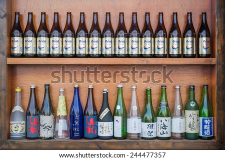 Kaohsiung, Taiwan, Oct,18,2014 : An Izakaya Decorate The Wall of Store With Rows of Bottles of Japanese Sakes .There Are Many Japanese Restaurant in Taiwan. They Bring Japanese Foods And Life Styles.  - stock photo