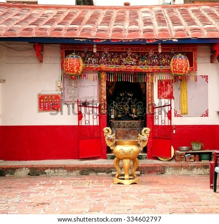 KAOHSIUNG, TAIWAN -- OCTOBER 17, 2015: The small Nan-Tian temple is housed in a traditional Chinese building in a local neighborhood of the Zuoying District. - stock photo