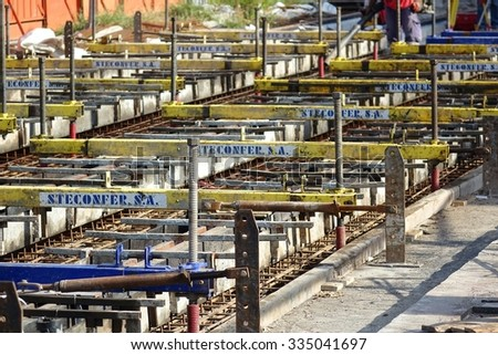 KAOHSIUNG, TAIWAN -- OCTOBER 8, 2015: Tracks are being laid as part of the construction of Kaohsiung City's light rail system.  - stock photo