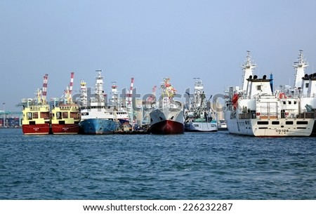 KAOHSIUNG, TAIWAN -- OCTOBER 11, 2014: View of a local shipyard at Kaohsiung port where small and medium sized vessels are being built. - stock photo