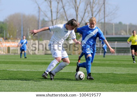 KAPOSVAR, HUNGARY - APRIL 20: Unidentified  players in action at Hungarian Cup Final women soccer game  MTK (blue) vs. Viktoria FC (white) April 20, 2011 in Kaposvar, Hungary. - stock photo