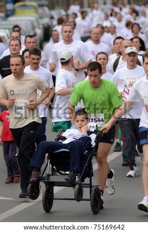 KAPOSVAR, HUNGARY - APRIL 3: Unidentified runners at the T-Home Vivicitta Running Race on April 3, 2011 in Kaposvar, Hungary. - stock photo
