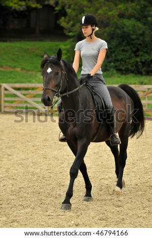 KAPOSVAR, HUNGARY - AUGUST 5: Leila Gyenesei (world champion in modern pentathlon) with her horse on a training , August 5, 2008 in Kaposvar, Hungary - stock photo