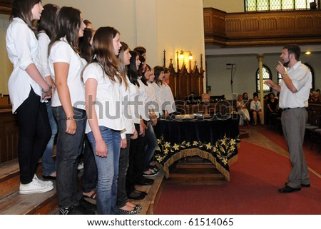 KAPOSVAR, HUNGARY - AUGUST 26: Members of the Franz Schubert Children's Choir (SVK) sing at the IV. Pannonia Cantat Youth Choir Festival August 26, 2010 in Kaposvar, Hungary - stock photo