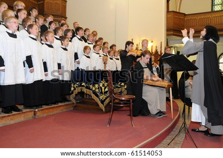 KAPOSVAR, HUNGARY - AUGUST 26: Members of the St Michael's boys Choir (EST) sing at the IV. Pannonia Cantat Youth Choir Festival August 26, 2010 in Kaposvar, Hungary - stock photo