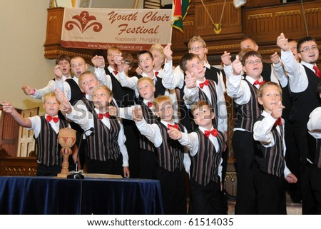 KAPOSVAR, HUNGARY - AUGUST 26: Members of the Suae Music School Choir (EST) sing at the IV. Pannonia Cantat Youth Choir Festival August 26, 2010 in Kaposvar, Hungary - stock photo