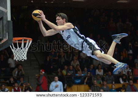 KAPOSVAR, HUNGARY - DECEMBER 22: An unidentified player in action at FACE TEAM Acrobatic Basketball Show, December 22, 2012 in Kaposvar, Hungary - stock photo