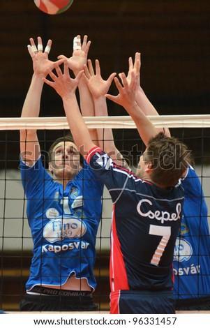 KAPOSVAR, HUNGARY - FEBRUARY 23:Alpar Szabo (L) in action at a Hungarian volleyball National Championship game Kaposvar (blue) vs. Csepel (deep blue), on February 23, 2012 in Kaposvar, Hungary. - stock photo