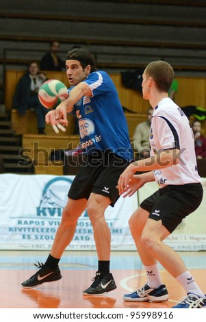 KAPOSVAR, HUNGARY - FEBRUARY 23: Andras Geiger (L) in action at a Hungarian volleyball National Championship game Kaposvar (blue) vs. Csepel ( deep blue), on February 23, 2012 in Kaposvar, Hungary. - stock photo