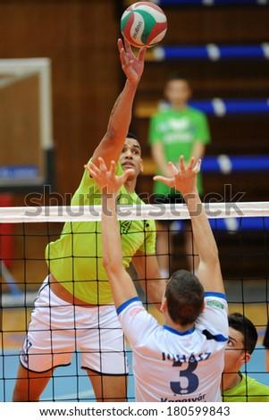 KAPOSVAR, HUNGARY - FEBRUARY 25: Domotor Meszaros (grren 4) in action at a Hungarian National Championship volleyball game Kaposvar (white) vs. Sumeg (green), February 25, 2014 in Kaposvar, Hungary. - stock photo