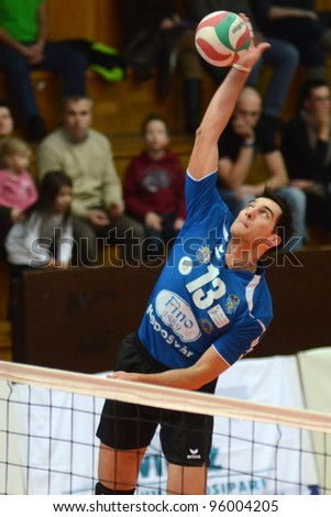 KAPOSVAR, HUNGARY - FEBRUARY 23: Gabor Nacsa in action at a Hungarian volleyball National Championship game Kaposvar (blue) vs. Csepel ( deep blue), on February 23, 2012 in Kaposvar, Hungary. - stock photo