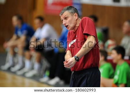 KAPOSVAR, HUNGARY - FEBRUARY 25: Peter Meszaros (Sumeg trainer) in action at a Hungarian Championship volleyball game Kaposvar (white) vs. Sumeg (green), February 25, 2014 in Kaposvar, Hungary. - stock photo