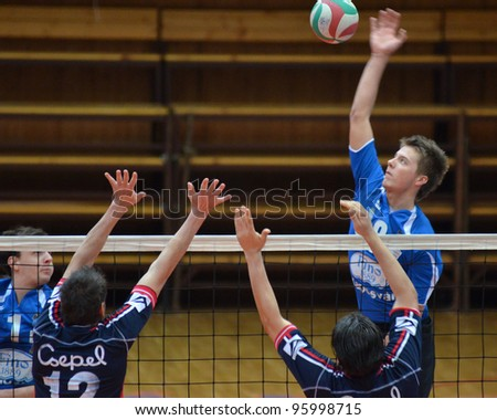 KAPOSVAR, HUNGARY - FEBRUARY 23: Roland Gergye (R) in action at a Hungarian volleyball National Championship game Kaposvar (blue) vs. Csepel ( deep blue), on February 23, 2012 in Kaposvar, Hungary. - stock photo