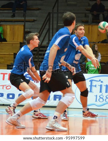 KAPOSVAR, HUNGARY - FEBRUARY 23: Unidentified players in action at a Hungarian volleyball National Championship game Kaposvar (blue) vs. Csepel ( deep blue), on February 23, 2012 in Kaposvar, Hungary. - stock photo