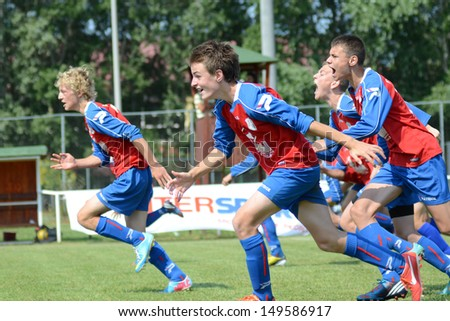 KAPOSVAR, HUNGARY - JULY 20: Minsk players celebrate at the IX. Youth Football Festival match Minsk (red) (BLR) vs. Brasov (yellow) (ROM) on July 20, 2013 in Kaposvar, Hungary - stock photo