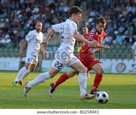 KAPOSVAR, HUNGARY - MAY 14: Bojan Pavlovic (in white 22) in action at a Hungarian National Championship soccer game - Kaposvar vs Szolnok on May 14, 2011 in Kaposvar, Hungary. - stock photo