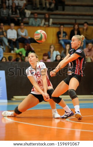 KAPOSVAR, HUNGARY - SEPTEMBER 20: Rebeka Rak (white 16) in action at the Hungarian I. League volleyball game Kaposvar (white) vs Ujpest (purple), September 20, 2013 in Kaposvar, Hungary. - stock photo