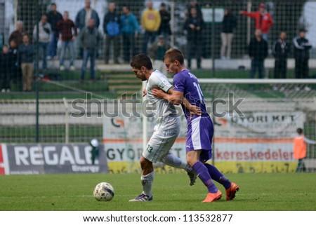 KAPOSVAR, HUNGARY - SEPTEMBER 14: Unidetified players in action at a Hungarian Championship soccer game - Kaposvar (white) vs Ujpest (purple) on September 14, 2012 in Kaposvar, Hungary. - stock photo