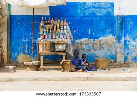 KARA, TOGO - MARCH 11, 2012: Unidentified Togolese kids have to sell products for living in Togo, Mar 11, 2012. People in Togo suffer of poverty due to unstable economical situation - stock photo