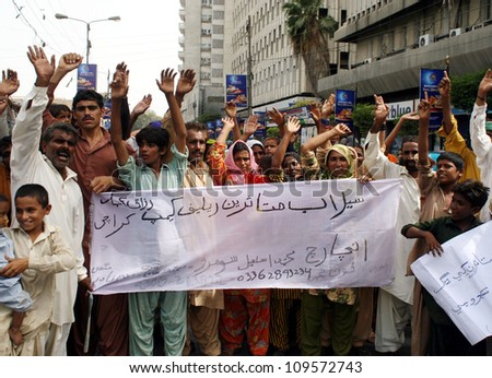 KARACHI, PAKISTAN - AUG 07: Flood affectees are protesting in favor of their demands  during a demonstration at Karachi Press Club on August 07, 2012 in Karachi. - stock photo