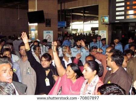 KARACHI, PAKISTAN - FEB 08: Members of Airlines Pilot Association chant slogans in favor of their demands during protest demonstration at Jinnah International Airport on February 08, 2011in Karachi. - stock photo