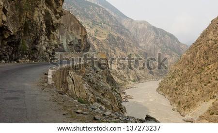 Karakorum Highway in the narrow Indus Gorge in Pakistan. - stock photo